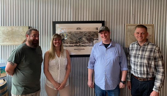Pictured from left to right, Jonathan Wright, owner of Redbeard Brewing Company; Jessica Goode, general manager of BLU Point Seafood Co., Matt Hull, chef of BLU Point Seafood Co. and Ricky Shickle, vice president of Operations for Zynodoa and BLU Point Seafood Co.