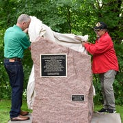 Mayor Dave Kleis and former director of the American Indian Center at St. Cloud State University Jim Knutson-Kolodzne unveil a new historical marker honoring Native Americans who settled in the St. Cloud region, Friday, June 28, 2019 at Riverside Park.