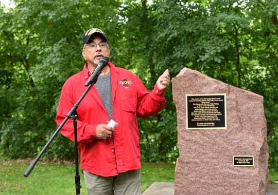 Jim Knutson-Kolodzne, former director of the American Indian Center at St. Cloud State University, speaks at an event unveiling a new historical marker honoring Native Americans who settled in the St. Cloud region, Friday, June 28, 2019 at Riverside Park.