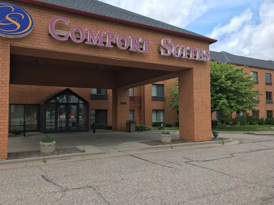Police arrested one man after a shooting Thursday morning at Comfort Suites hotel on 300 N. Division St. Another man was injured and taken to the hospital.