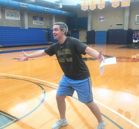 TCC men's basketball head coach Zach Settembre calls out plays during summer workouts.
