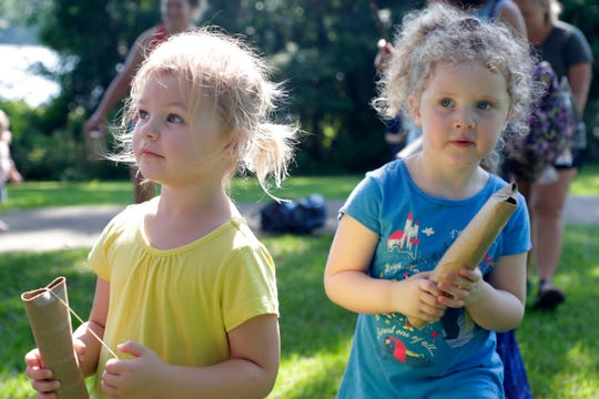 Raleigh Perrin, 3, left, and her friend Ella Delay, 4, play instruments they made from old paper towel rolls and rubber bands while spending the morning at Maclay Gardens Friday, June 28, 2019.