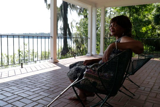 Dr. Felita McNeill chats with her friend while enjoying the lakeview from a shaded area at Maclay Gardens Friday, June 28, 2019.