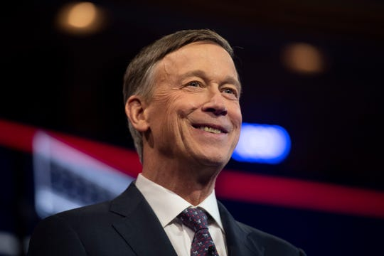 Democratic presidential primary candidate Gov. John Hickenlooper enters the debate stage Thursday, June 27, 2019, at the Adrienne Arsht Center for the Performing Arts in Miami.