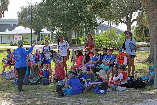 Beachland Elementary School students are briefed by an ORCA scientist before sailing to the breakwater site along the western shoreline of the Indian River Lagoon. Over the past year, students and volunteers have transported over 30 tons of fossilized shells in 60-pound mesh bags to sites along the lagoon, just north of the Barber Bridge in Vero Beach.