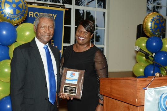 Neville Lake and Dawn Bloomfield at the Port St. Lucie Rotary Club's 38th Annual Installation & Awards Celebration at the Santa Lucia River Club.