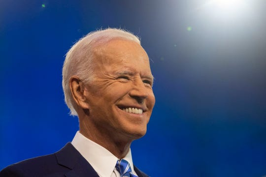 Democratic presidential primary candidate Vice President Joe Biden enters the debate stage Thursday, June 27, 2019, at the Adrienne Arsht Center for the Performing Arts in Miami.