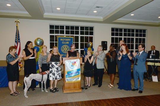 District Gov. Donna Marie Gaiser, center, introduces the 2019-20 board, from left, Paula Andreozzi, Angela Hayle, Betty L. Thorne Shearer, President Claudia McCaskill, Connie Cox, Tony Molinari, Dawn Bloomfield, Gary Smith and Susan and Dr. William Olivos at the Port St. Lucie Rotary Club's 38th Annual Installation & Awards Celebration at the Santa Lucia River Club.
