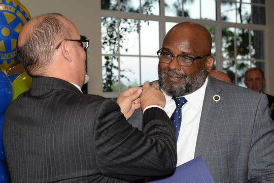Assistant District Gov. Lyle Fried, left, presents the Paul Harris Fellowship Award pin to St. Lucie County Boys & Girls Clubs CEO Will Armstead at the Port St. Lucie Rotary Club's 38th Annual Installation & Awards Celebration at the Santa Lucia River Club.