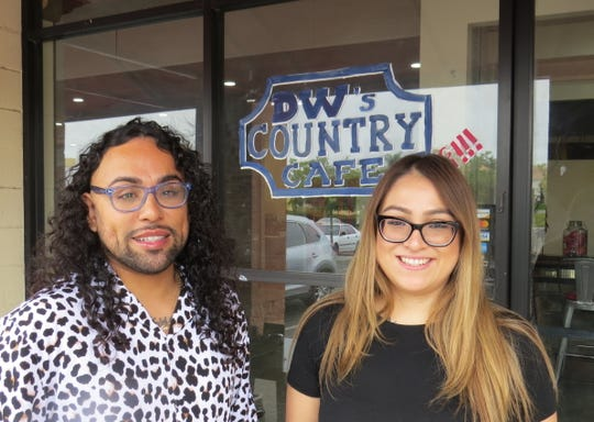 """Cousins Joseph """"Jo Jo"""" Morales Ramirez, left, and Alexia Garcia pose outside the new Ventura location of their family-owned restaurant, DW's Country Cafe."""