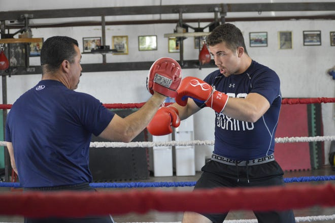Tulare native Richard Torrez Jr., right, trains with his father, Richard Torrez Sr. in 2019.
