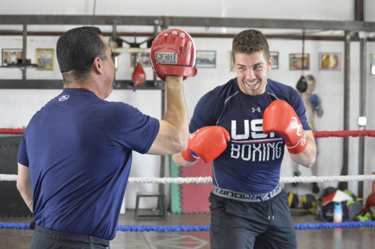 Tulare's Richard Torrez Jr., an amateur boxer, trains with his father, Richard Torrez Sr., in 2019.