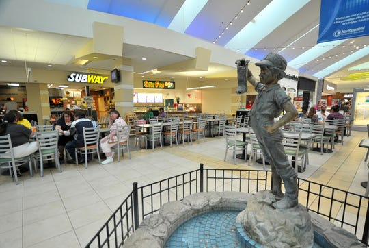 Shoppers eat at the food court in the Wausau Center mall on May 27, 2014.