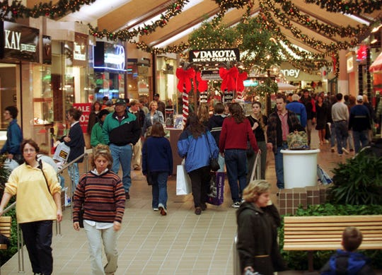 Hundreds of shoppers fill the Wausau Center Mall during the holiday shopping season in November 1999.