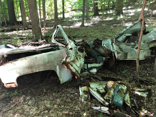 The remains of abandoned vehicles in Sprain RIdge Park.