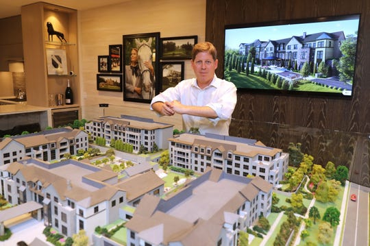 Alan Weissman, the developer with Alfred Weissman Real Estate, is pictured June 28, 2019, with a model of the St. Regis Residences being constructed in Rye.