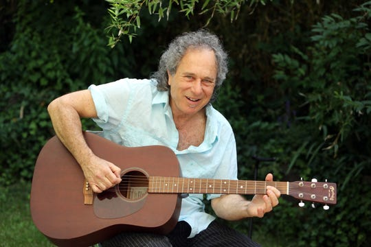 "Musician Rob Stoner, who still performs local gigs and is a guitar instructor, plays the guitar at home in Nyack June 28, 2019. Stoner, who played bass and sang during Bob Dylan's Rolling Thunder Revue, reflected on the new Netflix film, ""Rolling Thunder Revue: A Bob Dylan Story by Martin Scorsese."""