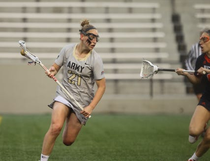 Mahopac's Caroline Raymond, shown carrying the ball for Army this spring, was both the Patriot League and ECAC women's lacrosse Rookie of the Year.