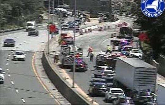 The scene after two tractor-trailers crashed on northbound Interstate 95 around Exit 21 in Rye, Friday, June 28, 2019, as seen on a Thruway Authority traffic camera image.