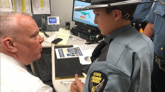 Lt. Millard Greer talks to Brett Holbrook, who's visiting every state's officers.