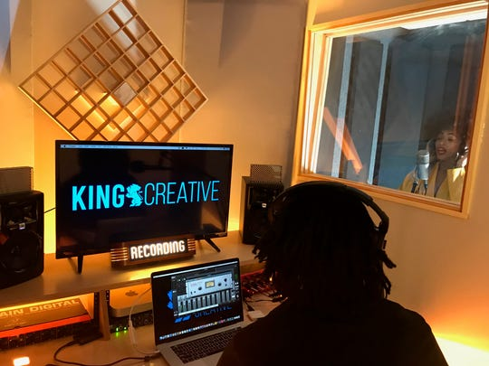 Nadjah Nicole performs during a session at King Creative's new Wilmington studio. Her husband, Ish, will be King Creative's main audio producer.