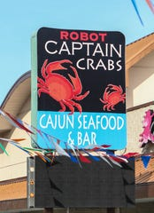 Robot Captain Crabs Cajun Seaford & Bar at 1130 Capitol Trail.