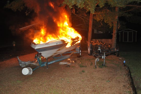 Lightning started a fire that destroyed a boat in the Adams County town of Rome early Friday.