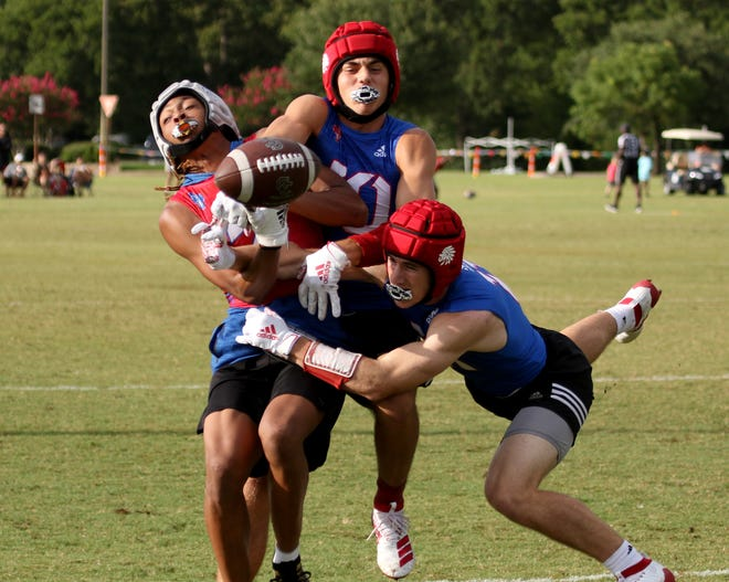 Jim Ned defenders break up a pass against Waco Connally in the state 7-on-7 tournament Thursday at the Veterans Park and Athletic Complex in College Station.