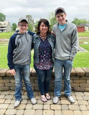 Tristin (right) with his mother Jessica and little brother Chase on Mother's Day.
