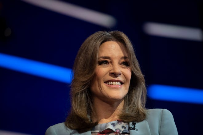 Democratic presidential primary candidate Marianne Williamson enters the debate stage Thursday, June 27, 2019, at the Adrienne Arsht Center for the Performing Arts in Miami. Leah Voss/Treasure Coast Newspapers via USA TODAY NETWORK (Via OlyDrop)