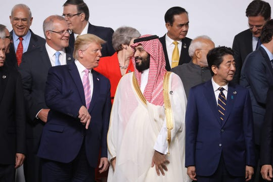 US President Donald Trump and Saudi Arabia Crown Prince Mohammed Bin Salman speak during a photo session at the G20 summit on Friday.