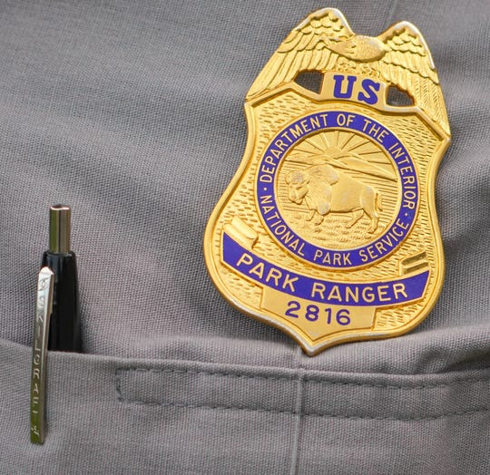 A close-up of seasonal National Park Service ranger Iliana Rosa's badge.