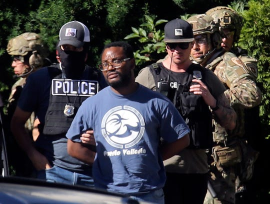 Salt Lake City police arrest Ayoola A. Ajayi on June 28, 2019, in connection with missing University of Utah student MacKenzie Lueck, who disappeared after taking a Lyft on June 17, 2019, from the Salt Lake City airport to a park.