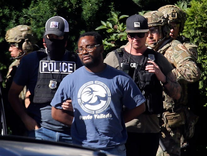 Salt Lake City police take Ayoola A. Ajayi into custody on June 28, 2019.