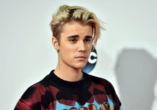 Justin Bieber says he was joking when he challenged Tom Cruise to a bout in the Octagon.