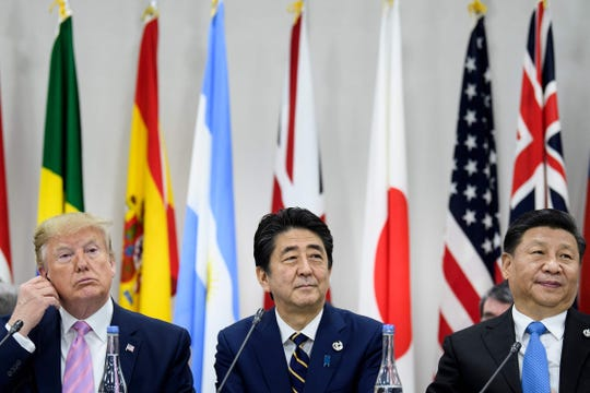 Left to right, President Donald Trump, Japan Prime Minister Shinzo Abe, and China President Xi Jinping attend a meeting at the G20 Summit on Friday.