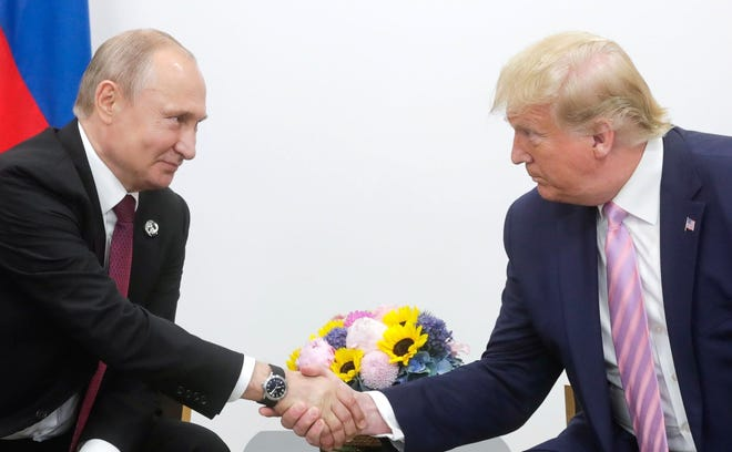 epa07679921 A handout picture made available on official website of President of Russia, shows Russian President Vladimir Putin (L) shaking hands with US President Donald J. Trump (R) during their meeting on the sidelines of the G20 summit in Osaka, Japan, 28 June 2019. In the first time Japan hosts a G20 summit. The summit gathers leaders from 19 countries and the European Union to discuss topics such as global economy, trade and investment, innovation and employment.  EPA-EFE/RUSSIAN PRES. PRESS OFFICE / HANDOUT  HANDOUT EDITORIAL USE ONLY/NO SALES ORG XMIT: FET71