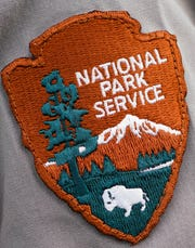 A close-up showing a park ranger's uniform patch.
