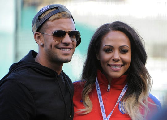 Oct 28, 2014; Kansas City, MO, USA; USA women's soccer player Sydney LeRoux (right) and Sporting KC player Dom Dwyer pose on the field before game six of the 2014 World Series between the Kansas City Royals and the San Francisco Giants at Kauffman Stadium.