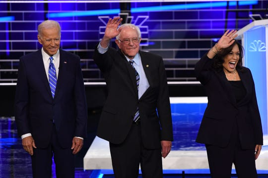 Former Vice President Joseph R. Biden, Sen. Bernie Sanders I-Vt., and Sen. Kamala Harris, D-Calif., arrive to participate in the second Democratic primary debate in Miami on June 27, 2019.