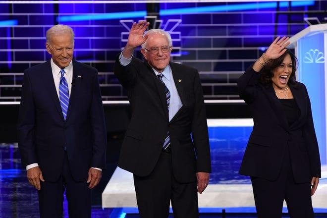 Former Vice President Joseph R. Biden, Sen. Bernie Sanders I-Vt., and Sen. Kamala Harris, D-Calif., arrive to participate in the second Democratic primary debate in Miami on June 27, 2019.