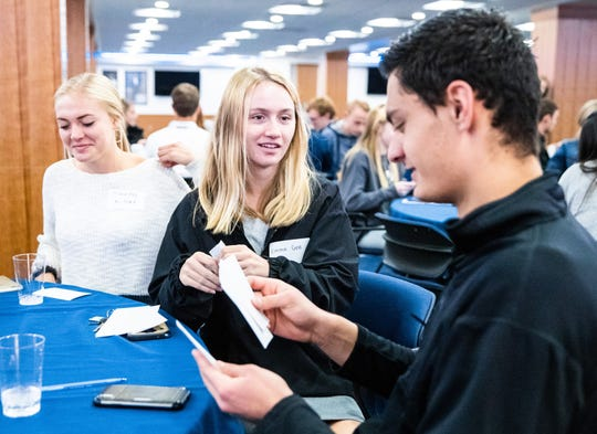 "Emma Gee, middle, interacts with other students at the NCAA's Common Ground ""Think Tank,"" an inclusion and religious seminar hosted on BYU's campus. Hosted in fall of 2018, it was the first time an LGBT-focused summit took place on the Mormon school's campus."