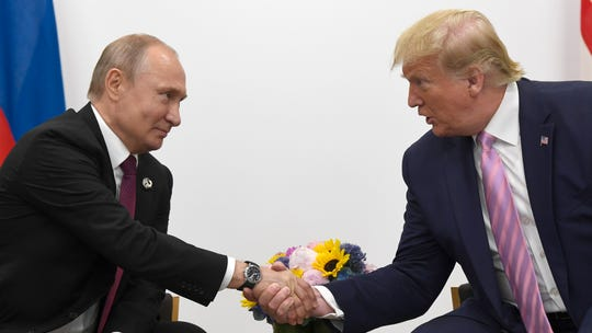 President Donald Trump shakes hands with Russian President Vladimir Putin on Friday during a bilateral meeting on the sidelines of the G-20 summit in Osaka, Japan.