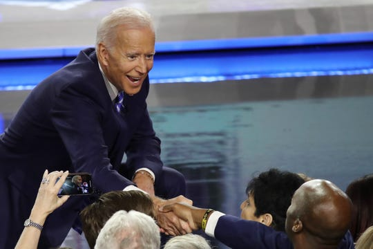Former Vice President Joe Biden greets members of the audience after the second night of the first Democratic presidential debate in Miami on June 27, 2019.