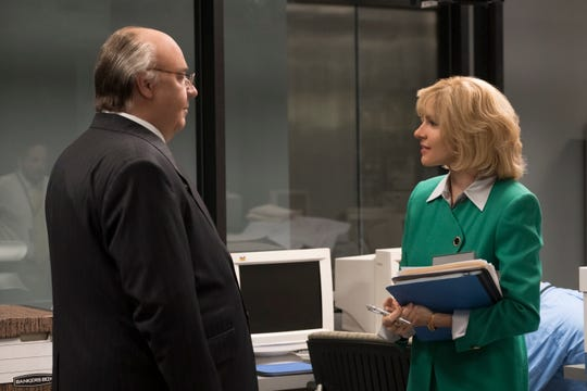 Fox News chief Roger Ailes (Russell Crowe), left, talks to his girlfriend and work subordinate, Elizabeth Tilson (Sienna Miller), in Showtime's 'The Loudest Voice.' They would eventually get married.
