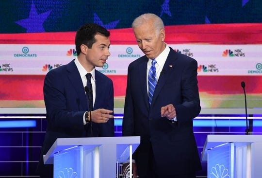 Former Vice President Joseph Biden, right, and Mayor of South Bend, Indiana Pete Buttigieg talk before the second Democratic primary debate in Miami on June 27, 2019.