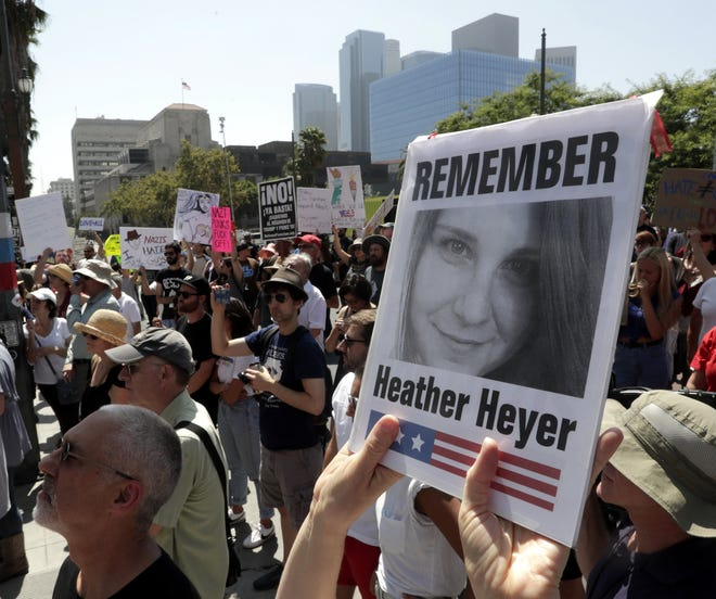 A demonstrator in Los Angeles holds up a picture of Heather Heyer during a  demonstration in front of City Hall for victims of Charlottesville, Virginia tragedy and against racism on August 13, 2017.