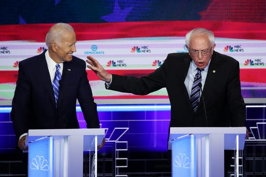 Democratic presidential candidates former Vice President Joe Biden and Sen. Bernie Sanders (I-VT) speak during the second night of the first Democratic presidential debate on June 27, 2019 in Miami, Florida.