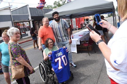 "The City of Pineville held the second ""5th Saturday Market on Main"" Saturday, June 29, 2019. The day included vendors, classic cars, a Kung Fu demontration, music by Bubba Alwell, The Rhythm Kings. Shawn Christian and Paul Boudini. On hand to meet and sign autographs was former Pineville High School football player Cody Ford who was recently drafted by the Buffalo Bills."