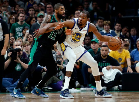 Jan 26, 2019; Boston, MA, USA; Golden State Warriors forward Kevin Durant (35) works against Boston Celtics guard Kyrie Irving (11) during the second half of a 115-111 victory by Golden State at TD Garden. Mandatory Credit: Winslow Townson-USA TODAY Sports